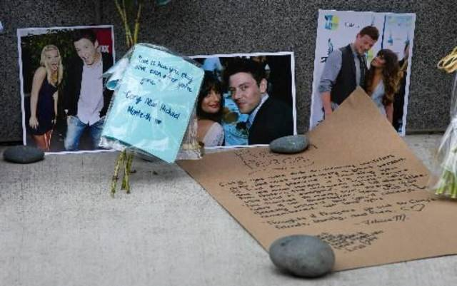 Photographs and notes are placed at a memorial for Canadian actor Cory Monteith outside the Fairmont Pacific Rim Hotel in Vancouver, British Columbia on Monday July 15, 2013. Monteith, 31, was found dead in his room at the hotel on Saturday, according to police, who have ruled out foul play. (AP Photo/The Canadian Press)