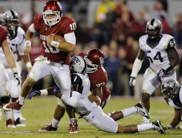 Oklahoma quarterback Blake Bell runs past TCU's Chris Hackett during the Sooners' 20-17 win Saturday. PHOTO BY CHRIS LANDSBERGER, THE OKLAHOMAN