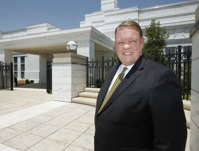 Kevin Graves, a leader with the Oklahoma City Stake of the Church of Jesus Christ of Latter-day Saints, poses in front of the LDS Surrey Hills Temple in Yukon, OK, Tuesday, July 5, 2011. By Paul Hellstern, The Oklahoman