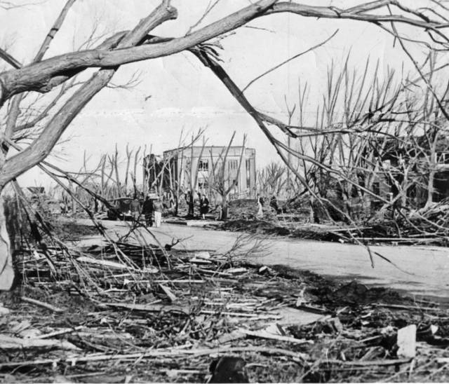 TORNADO DAMAGE: Bare tree limbs rise eerily as the damaged Woodward County courthouse stands in the background after a tornado struck April 9, 1947.  The tornado killed 95 persons in Woodward, Okla. and covered parts of three states.