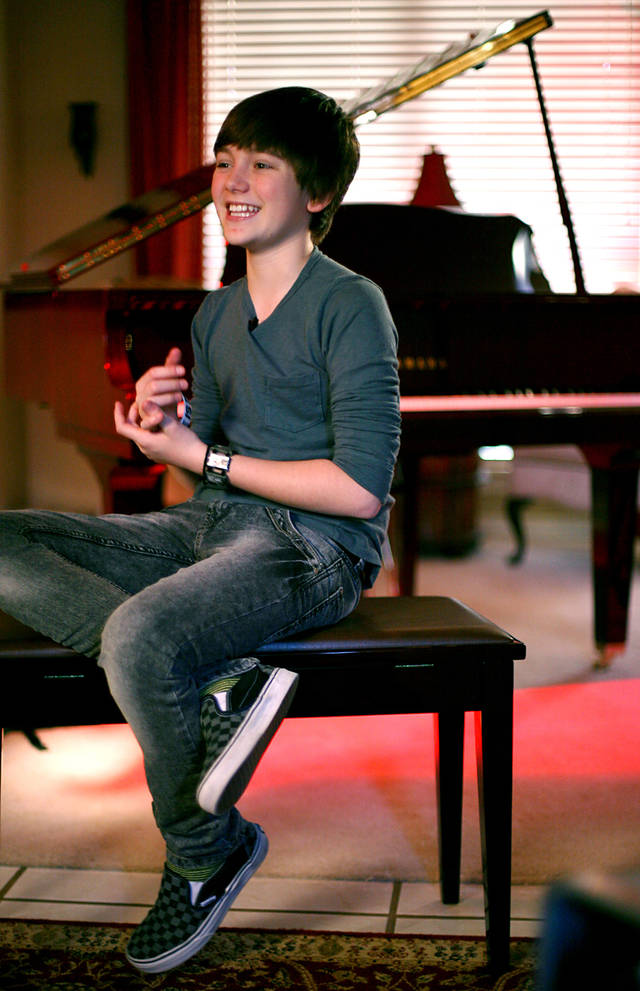 Greyson Chance talks about his new Yamaha piano at his family's home in Edmond on Friday, Oct. 8, 2010. Photo by John Clanton, The Oklahoman