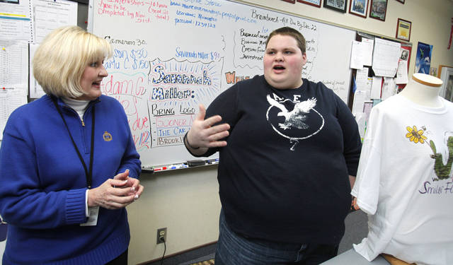 Moore Norman Technology Center student Adam Graham talks with Entrepreneurship Instructor Nancy Holt on Thursday, Jan. 12, 2012, in Norman, Okla.   Photo by Steve Sisney, The Oklahoman