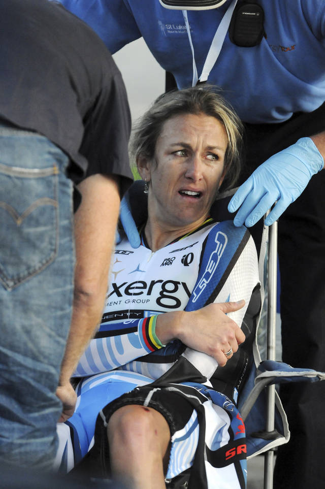 Olympic gold medalist Kristin Armstrong is consulted by medical personnel after finishing the time trial in the Exergy Tour cycling competition, Thursday, May 24, 2012, in Boise, Idaho. Armstrong crashed in the race and was taken to the hospital for evaluation. She finished 11th in the time trial. (AP Photo/The Idaho Press-Tribune, Charlie Litchfield) MANDATORY CREDIT