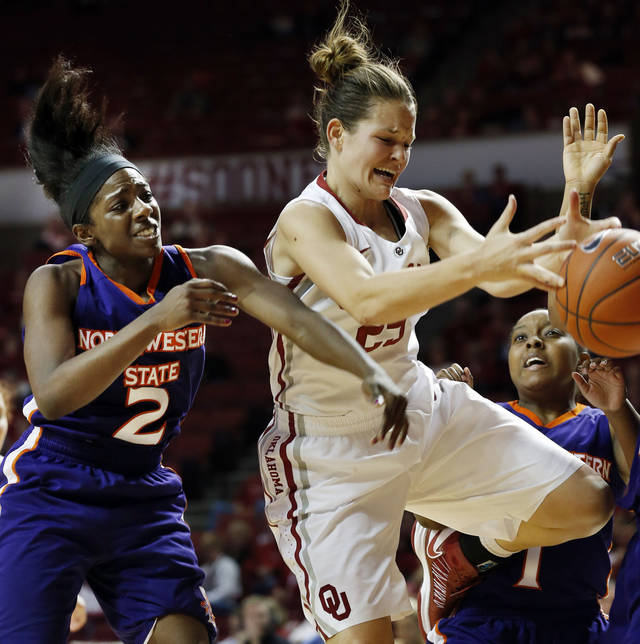 Oklahoma Sooners' Whitney Hand (25) and Northwestern State Lady Demons' Tiandra Williams (2) battle for a rebound during the second half as the University of Oklahoma (OU) Sooner women's basketball team plays the Northwestern State Lady Demons at the Lloyd Noble Center on Thursday, Nov. 29, 2012  in Norman, Okla. Photo by Steve Sisney, The Oklahoman
