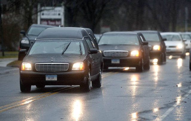 The funeral precession For Rachel D'Avino makes its way down East Street in Bethlehem, Conn. on Friday Dec. 21, 2012.  D'Avino was killed when Adam Lanza walked into Sandy Hook Elementary School in Newtown, Conn., Dec. 14, and opened fire, killing 26 people, including 20 children, before killing himself.  (AP Photo/The Republican-American, Jim Shannon) MANDATORY CREDIT