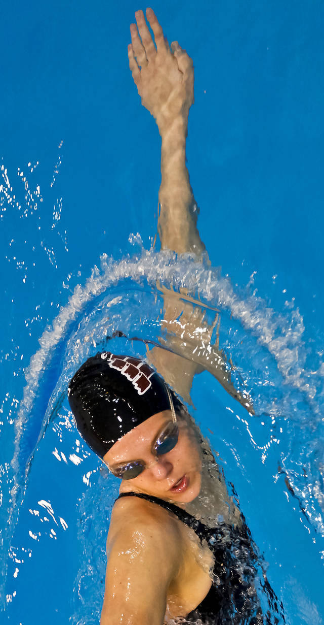 A competitor warms up with a freestyle swim before competing during the NAIA Swimming and Diving National Championships at Oklahoma City Community College on Thursday, March 1, 2012, in Oklahoma City, Oklahoma. Photo by Chris Landsberger, The Oklahoman