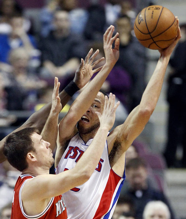Detroit Pistons forward Tayshaun Prince, right, tries to pass under pressure from Milwaukee Bucks guard Beno Udrih in the first half of an NBA basketball game Tuesday, Jan. 29, 2013, in Auburn Hills, Mich. (AP Photo/Duane Burleson)