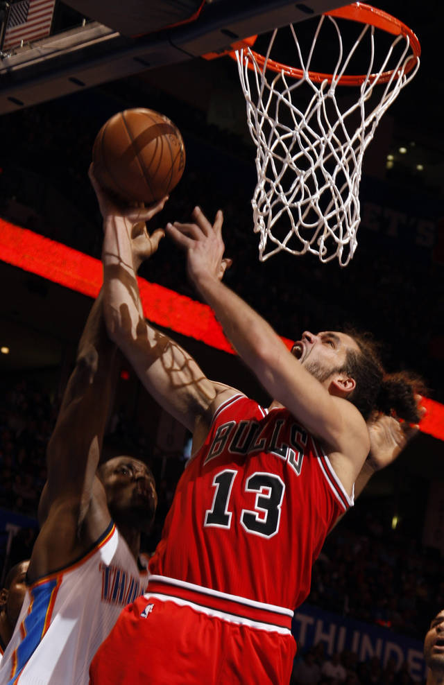 Chicago's Joakim Noah (13) shoots as Oklahoma City's Serge Ibaka (9) defends during the NBA game between the Oklahoma City Thunder and the Chicago Bulls at Chesapeake Energy Arena in Oklahoma City, Sunday, Feb. 24, 2013. Photo by Sarah Phipps, The Oklahoman
