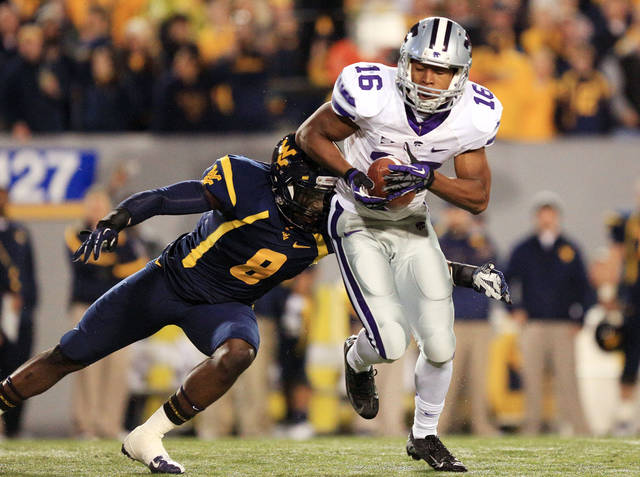 Kansas State wide receiver Tyler Lockett (16) avoids a tackle by West Virginia's Karl Joseph (8) after a pass from quarterback Collin Klein during the first quarter of an NCAA college football game in Morgantown, W.Va., Saturday, Oct. 20, 2012. (AP Photo/Christopher Jackson)   ORG XMIT: WVCJ101