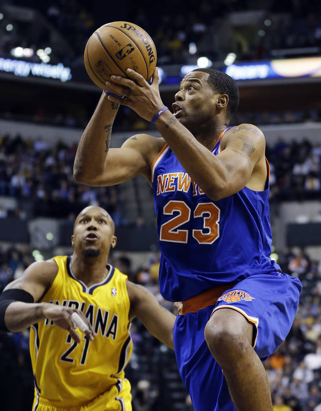 New York Knicks' Marcus Camby (23) goes to the basket against Indiana Pacers' David West (21) during the first half of an NBA basketball game, Thursday, Jan. 10, 2013, in Indianapolis. (AP Photo/Darron Cummings)