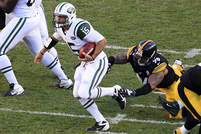 New York Jets quarterback Tim Tebow (15) breaks away from Pittsburgh Steelers defensive end Ziggy Hood (96) during the third quarter of an NFL football game in Pittsburgh, Sunday, Sept. 16, 2012. The Steelers won 27-10. (AP Photo/Gene J. Puskar)