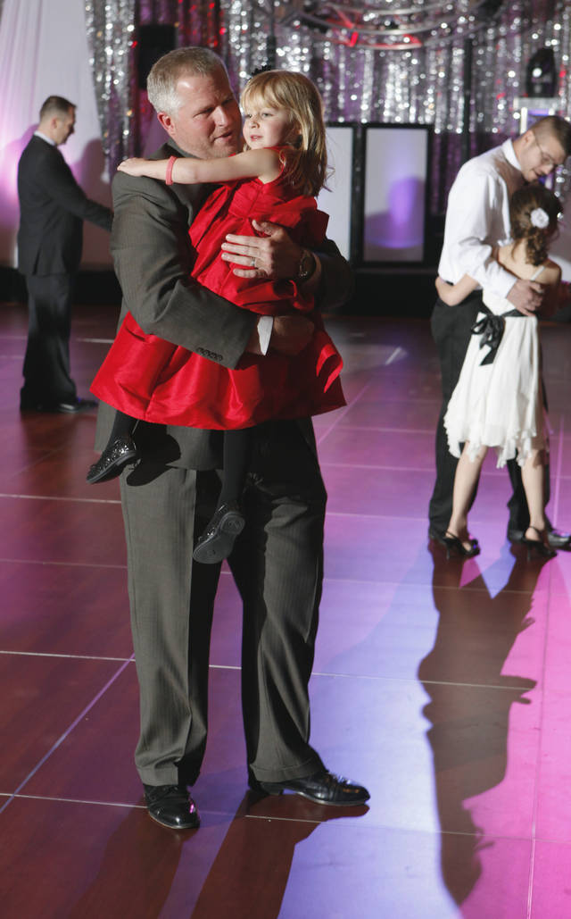 Heath Hans and daughter Campbell, 4, are among the first on the dance floor at the annual Daddy Daughter Dance sponsored by the city's Parks and Recreation Department at the Embassy Suites hotel on Saturday, February 5, 2011, in Norman, Okla.   Photo by Steve Sisney, The Oklahoman