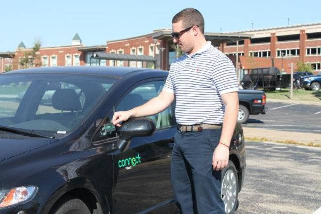 Oklahoma State University graduate student Ross Cortese demonstrates how Hertz on Demand members can access one of two compressed natural gas-fueled Honda Civics available on campus. Cortese works for the university's transit and parking services. <strong> - provided</strong>
