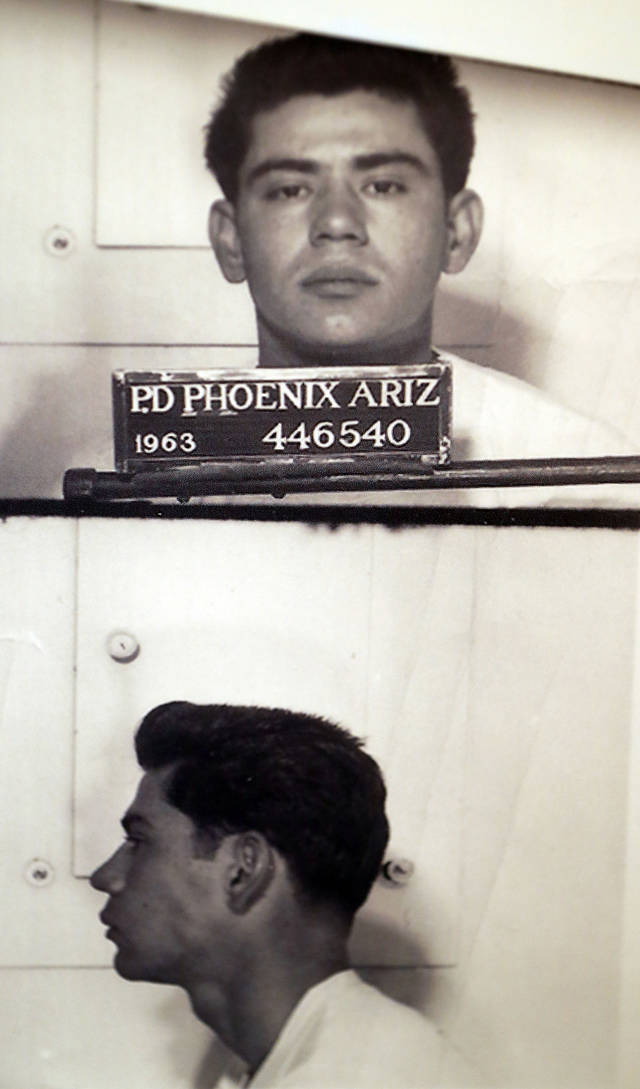 Booking photos of Ernesto Miranda are on display, Wednesday, March 13, 2013 at the Phoenix Police Museum in Phoenix. The arrest of Miranda on March 13, 1963, led to the landmark self-incrimination case that reached the Supreme Court and resulted in Miranda Rights that law enforcement uses when arresting a suspect. (AP Photo/Matt York)