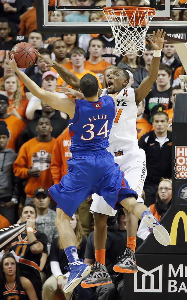 Oklahoma State 's Kamari Murphy (21) blocks a shot by Kansas' Perry Ellis (34) during the college basketball game between the Oklahoma State University Cowboys (OSU) and the University of Kanas Jayhawks (KU) at Gallagher-Iba Arena on Wednesday, Feb. 20, 2013, in Stillwater, Okla. Photo by Chris Landsberger, The Oklahoman