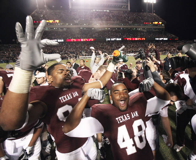 Texas A&M's Andrew Weaver, right, and Damontre Moore celebrate after the Aggies beat OU.  Photo by Bryan Terry, The Oklahoman