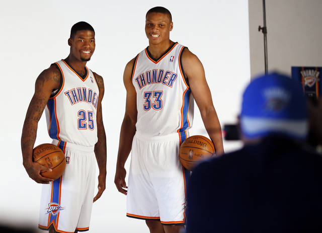 DeAndre Liggins, left, and Daniel Orton pose for a photo during media day for the Oklahoma City Thunder NBA basketball team at the Thunder Events Center in Oklahoma City, Monday, Oct. 1, 2012.  Photo by Nate Billings, The Oklahoman