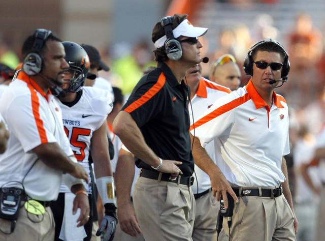 Oklahoma State head coach Mike Gundy watches the game during second half of a college football game between the Oklahoma State University Cowboys (OSU) and the University of Texas Longhorns (UT) at Darrell K Royal-Texas Memorial Stadium in Austin, Texas, Saturday, Oct. 15, 2011. Photo by Sarah Phipps, The Oklahoman