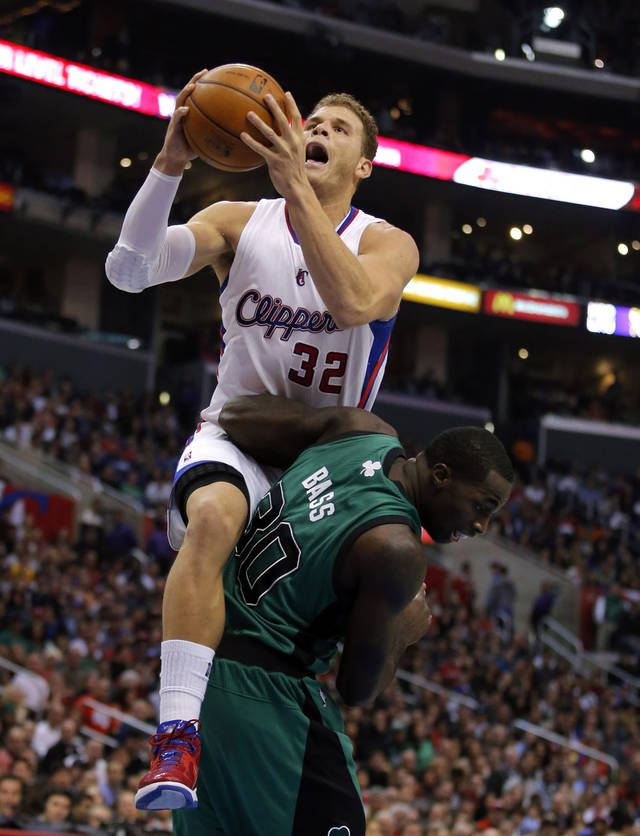 Los Angeles Clippers' Blake Griffin, top, shoots over Boston Celtics' Brandon Bass in the first half of an NBA basketball game in Los Angeles, Thursday, Dec. 27, 2012. (AP Photo/Jae C. Hong)