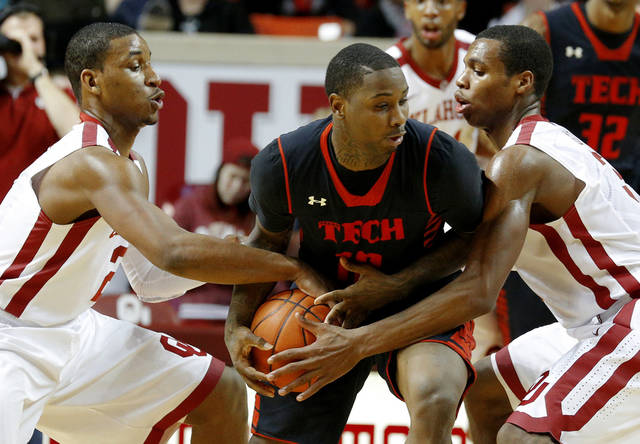 Oklahoma's Steven Pledger, left, and Oklahoma's Buddy Hield defend Texas Tech's Daylen Robinson (10) during an NCAA college basketball game between the University of Oklahoma and Texas Tech University at Lloyd Noble Center in Norman, Okla., Wednesday, Jan. 16, 2013. Photo by Bryan Terry, The Oklahoman