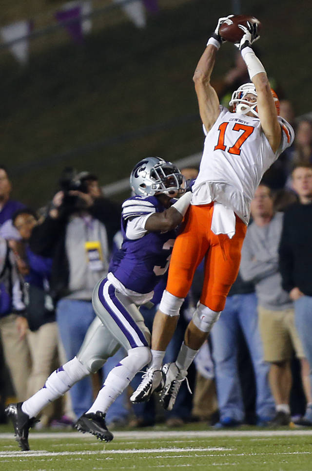 Oklahoma State's Charlie Moore (17) makes a catch over Kansas State's Allen Chapman (3) during the college football game between the Oklahoma State University Cowboys (OSU) and the Kansas State University Wildcats (KSU) at Bill Snyder Family Football Stadium on Saturday, Nov. 1, 2012, in Manhattan, Kan. Photo by Chris Landsberger, The Oklahoman