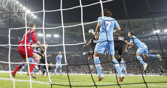 Juventus defender Martin Caceres, of Uruguay, center, heads the ball to score during a Serie A soccer match between Juventus and Napoli, at the Juventus stadium in Turin, Italy, Saturday, Oct. 20, 2012. Juventus won 2-0. (AP Photo/Luca Bruno)