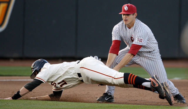 COLLEGE BASEBALL: Oklahoma's Caleb Bushyhead tags out Oklahoma State's Robbie Rea at third in the sixth inning of the college Bedlam baseball game between Oklahoma State University (OSU) and the University of Oklahoma (OU) at Allie P. Reynolds Stadium in Stillwater, Okla., Tuesday, April 24, 2012. Photo by Bryan Terry, The Oklahoman
