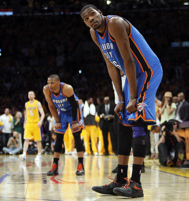 Oklahoma City's Kevin Durant (35) and Russell Westbrook (0) rest their hands on their knees late in the fourth quarter during Game 3 in the second round of the NBA basketball playoffs between the L.A. Lakers and the Oklahoma City Thunder at the Staples Center in Los Angeles, Friday, May 18, 2012. Photo by Nate Billings, The Oklahoman