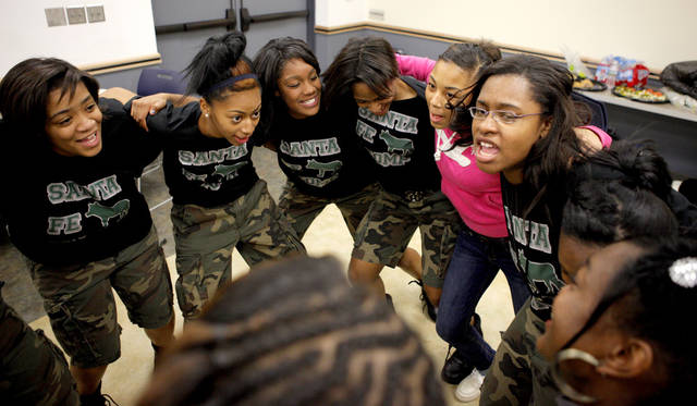 Members of the Edmond Santa Fe High School stomp dancing team and others huddle up on Feb. 7 before a dance performance at the Ralph Ellison Library in Oklahoma City. The team will perform live on the BET show �106 & Park.� Photo by Bryan Terry, The Oklahoman ARCHIVES