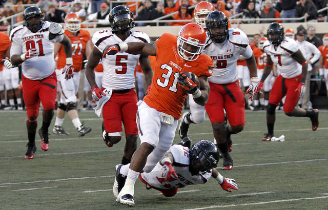 Oklahoma State's Jeremy Smith (31) runs past Texas Tech's D.J. Johnson (12) for a touchdown during the college football game between the Oklahoma State University Cowboys (OSU) and Texas Tech University Red Raiders (TTU) at Boone Pickens Stadium on Saturday, Nov. 17, 2012, in Stillwater, Okla.   Photo by Chris Landsberger, The Oklahoman