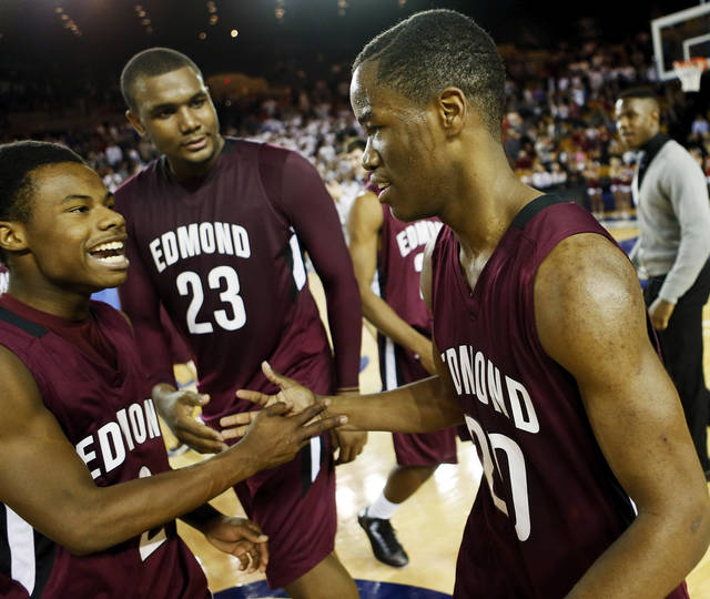 Edmond Memorial's Aaron Young (20) celebrates with teammates, including Terrel Bruner (2) and Shaquille Morris (23) after hitting the game-winning shot in a Class 6A boys high school basketball game in the semifinals of the state tournament at the Mabee Center in Tulsa, Okla., Friday, March 8, 2013. Edmond Memorial beat Owasso, 53-50, in double-overtime. Photo by Nate Billings, The Oklahoman