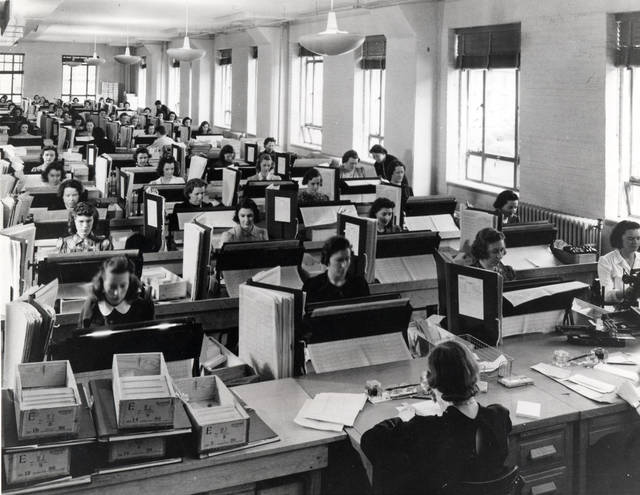 In this photo provided by the U.S. Census Bureau, tabulators in Washington record the information from the more than 120,000 enumerators who gathered data for the 1940 U.S. Census. Veiled in secrecy for 72 years because of privacy protections, the 1940 U.S. Census is the first historical federal decennial survey to be made available on the Internet initially rather than on microfilm. (AP Photo/National Archives and Records Administration)