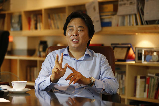 In this July 18, 2012 photo, Shin Cheol-soo, chief executive of ENA Industry, speaks at his office in Gyeongsan, south of Seoul, South Korea. Shin no longer sees his future in the United States. The South Korean auto parts supplier uprooted his family from Detroit this year and moved home to focus on selling to the new economic superpower: China. �The United States is a tiger with no power,� Shin said in his office, where three walls are lined with books, many about China. �Nobody can deny that China is the one now rising.� (AP Photo/Lee Jin-man)