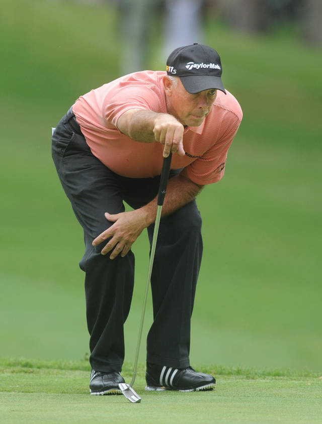 Tom Lehman lines up a putt on the second hole during the third round of the Champions Tour's Regions Tradition golf tournament, Saturday, June 9, 2012, at Shoal Creek in Birmingham, Ala. (AP Photo/The Birmingham News, Linda Stelter) MAGS OUT