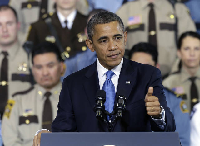President Barack Obama gestures as he speaks about his gun violence proposals, Monday, Feb. 4, 2013, at the Minneapolis Police Department's Special Operations Center in Minneapolis, where he outlined his plan before law enforcement personnel.  (AP Photo/Jim Mone)