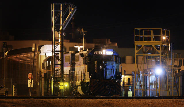 In this April 17, 2011 photo, a Mexican locomotive rolls slowly through a Vehicle and Cargo Inspection System (VACIS) as it crosses into El Paso, Texas, from Juarez, Chihuahua, Mexico. After the train crosses the border, the Mexican owned locomotives detach and are replaced by American engines. (AP Photo/Mark Lambie)