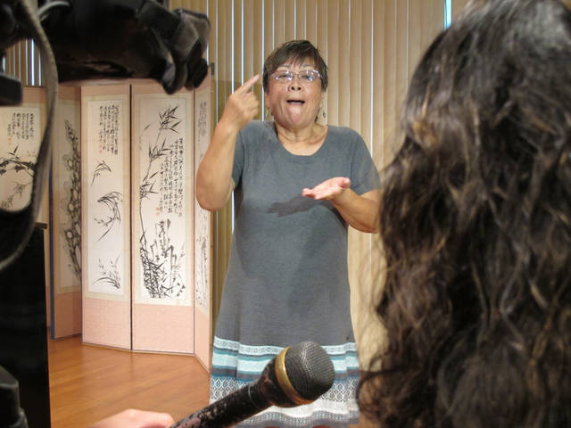 Linda Lambrecht uses Hawaii Sign Language at a press conference in Honolulu on Friday, March 1, 2013. Linguists say they've determined a Hawaii Sign Language is not a dialect of American Sign Language, as many long believed, but an unrelated language with unique vocabulary and grammar. (AP Photo/Audrey McAvoy)