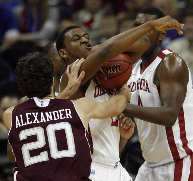 Oklahoma's Steven Pledger (2) fights for a rebound with Texas A&M's Daniel Alexander (20) during the Big 12 tournament men's basketball game between the Oklahoma  Sooners and the Texas A&M Aggies at the Sprint Center, Tuesday, March, 6, 2011. Photo by Sarah Phipps, The Oklahoman