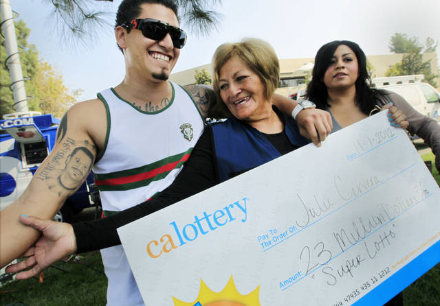   Lottery winner Julie Cervera, center, looks at her recently dead son pictured on a tattoo, as she is hugged by her grandson Rudy Ray, left, and daughter Charliena Marquez, right, after a news conference in San Bernardino, Calif., Friday, Nov. 2, 2012. The 69-year-old California grandmother came forward to claim a $23 million lottery jackpot after the winning ticket languished in her car&#039;s glove compartment for months and almost expired. With 180 days to claim the prize, Cervera only had until Nov. 25 to cash in. (AP Photo/Damian Dovarganes)  