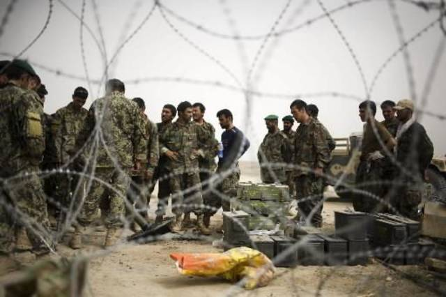 Afghan army soldiers arrive to reinforce U.S.  troops at Combat Outpost Nolen, in the volatile Arghandab Valley, in Kandahar,  Afghanistan, Thursday, July 22, 2010. (AP Photo/Rodrigo Abd)
