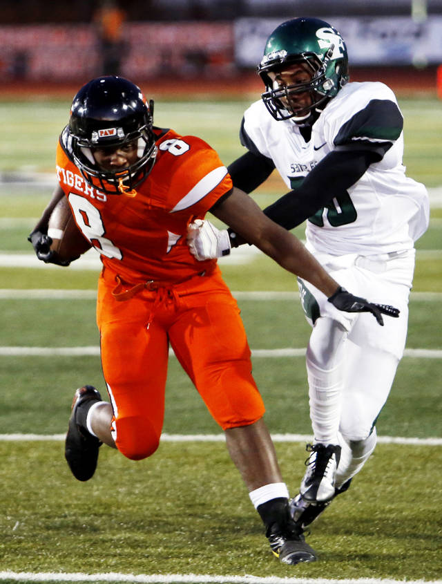 Norman's A'erion Hines (8) is dragged out of bounds after a run by Edmond's Eric Davis in high school football as the Norman High School Tigers play the Edmond Santa Fe  Wolves on Friday, Oct. 19, 2012 in Norman, Okla.  Photo by Steve Sisney, The Oklahoman