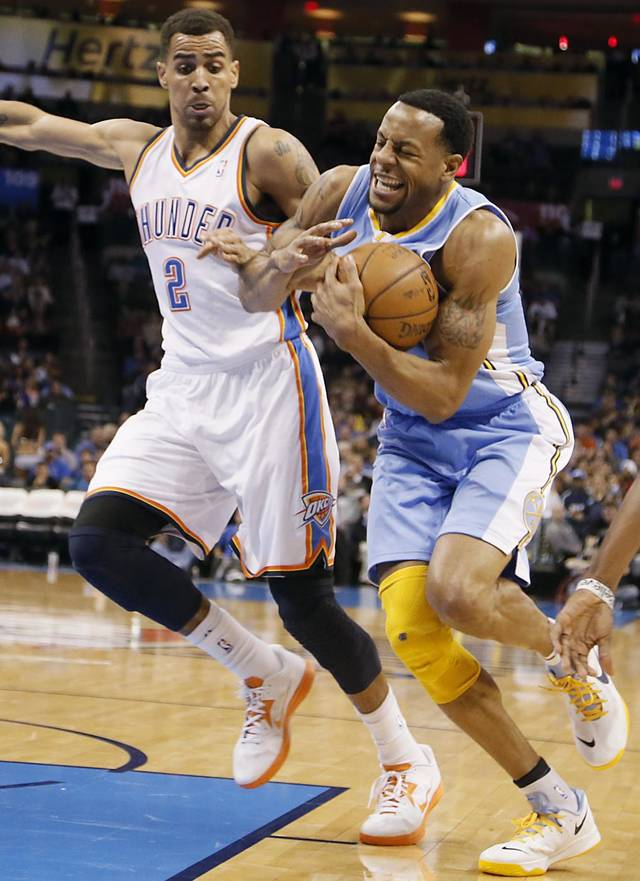 Oklahoma City's Thabo Sefolosha (2) battles with Denver's Andre Iguodala (9) during the NBA basketball game between the Oklahoma City Thunder and the Denver Nuggets at the Chesapeake Energy Arena on Wednesday, Jan. 16, 2013, in Oklahoma City, Okla.  Photo by Chris Landsberger, The Oklahoman