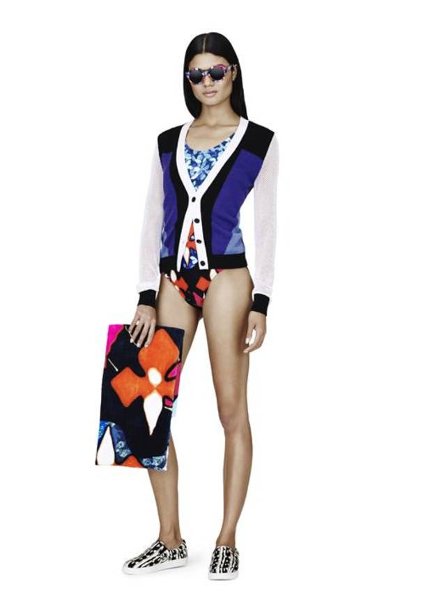 Color-block cardigan, $34.99;  print swimsuit, $34.99; beach towel, $24.99; sunglasses, $16.99; black adn wite print slip-on shoe, $29.99. Peter Pilotto for Target collection.