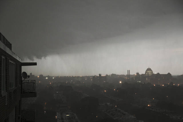 A thunderstorm rolls into the Brooklyn borough of New York on Thursday, July 26, 2012. An outbreak of severe thunderstorms including widespread damaging winds are sweeping over parts of New York with tornado warnings. (AP Photo/Bebeto Matthews)