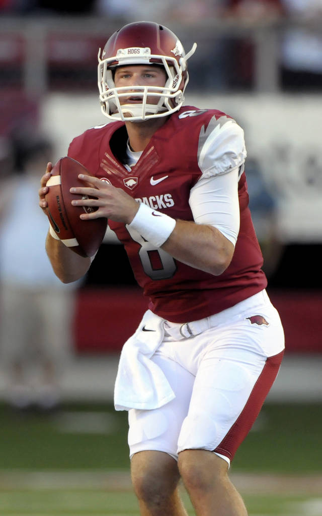 Arkansas quarterback Tyler Wilson looks for a receiver during the first half of an NCAA college football game with Louisiana-Monroe in Little Rock, Ark., Saturday, Sept. 8, 2012. (AP Photo/David Quinn)