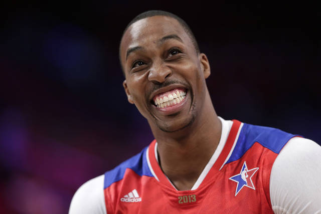 Dwight Howard of the Los Angeles Lakers smiles before the NBA All-Star basketball game Sunday, Feb. 17, 2013, in Houston. (AP Photo/Eric Gay)