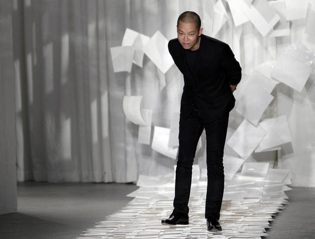 FILE - In this Sept. 9, 2011 file photo, designer Jason Wu takes a bow after presenting his Spring 2012 collection during Fashion Week in New York. Wu may have won international recognition for twice designing inaugural gowns for U.S. first lady Michelle Obama, but judges in his native Taiwan seem unimpressed. Taiwan&#039;s Intellectual Property Court ruled Monday, Jan. 21, 2013 that Wu&#039;s new label &quot;Miss Wu&quot; could not be registered as a brand because it was not distinctive enough. He designed Michelle Obama&#039;s white inaugural gown in 2008. On Monday, she appeared in another of his creations, a shiny gown with a red halter top. (AP Photo/Mary Altaffer, File)