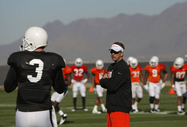 Oklahoma State offensive coordinator Todd Monken talks with Brandon Weeden (3) during the Oklahoma State Cowboys practice for the Fiesta Bowl at Scottsdale Community College in Scottsdale, Ariz.,  Tuesday, Dec. 27, 2011. Photo by Sarah Phipps, The Oklahoman