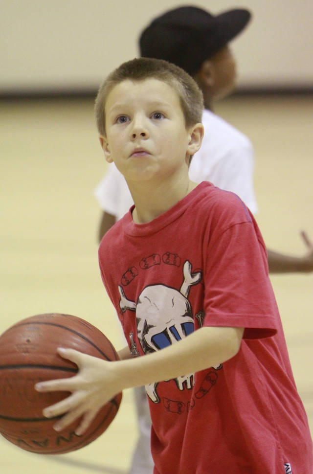 Ryan Bray, 9,  plays basketball in the Before and After School Care program  at the YMCA in Edmond, Thursday, December 22 , 2011.  Photo by David McDaniel, The Oklahoman