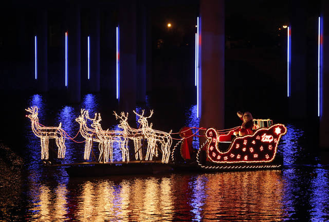Santa's sleigh participates during the Oklahoma River Boat Parade in Oklahoma City, Friday, Nov. 23, 2012.  Photo by Garett Fisbeck, The Oklahoman